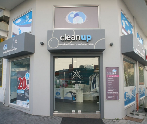 The exterior of a Clean Up laundry shop.