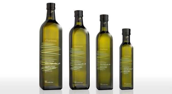 Charisma - Different size bottles of olive oil.