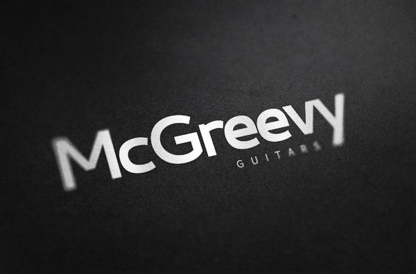 Brand name against dark textured paper - McGreevy Guitars
