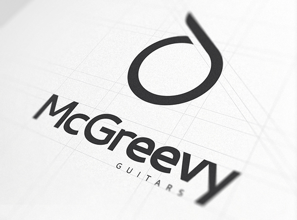 Brand Name and logo against white paper - McGreevy Guitars