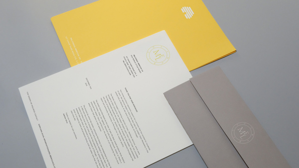 Various documents with the distinct logo